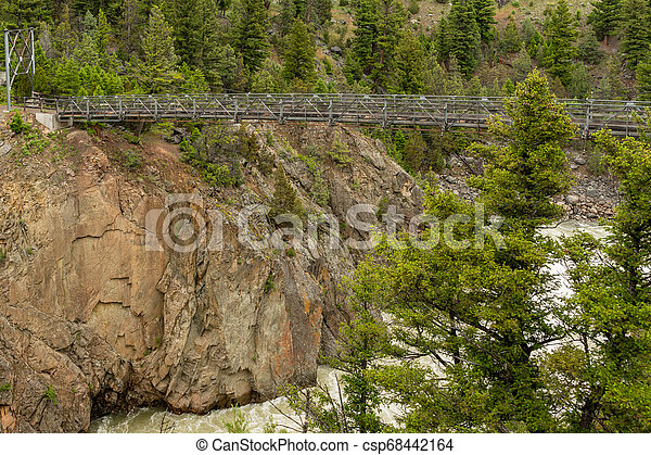 Suspension Bridge Over Hellroaring Creek - csp68442164