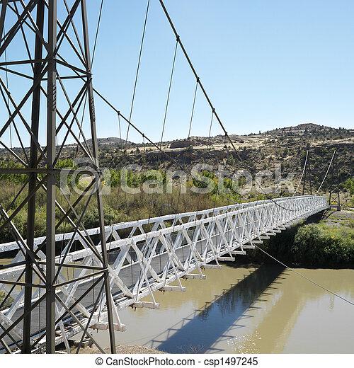 Suspension bridge over river. - csp1497245