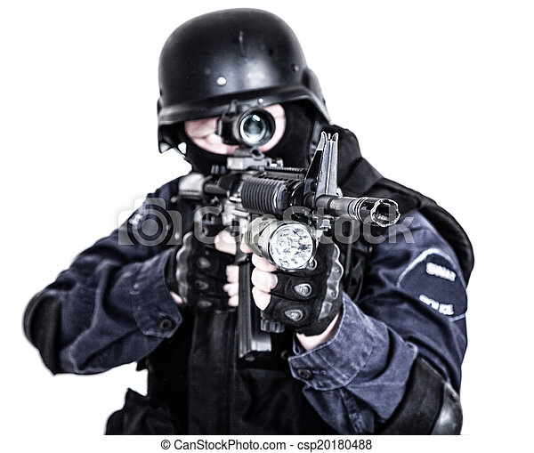 Swat officer. Special weapons and tactics swat team officer with his ...
