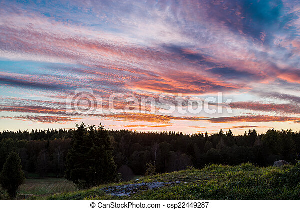 Swedish sunset over rural area - csp22449287