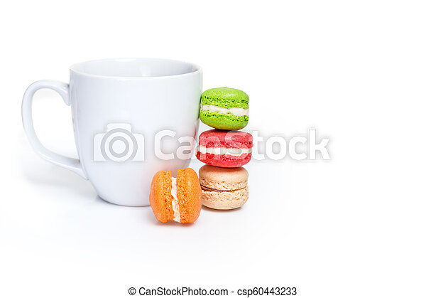 Sweet and colourful macaroons with cup of coffee on white background. Traditional french dessert. Copy space. - csp60443233
