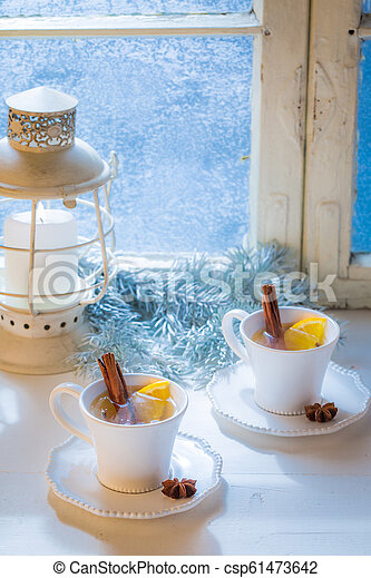 Sweet and hot tea with cinnamon and orange for Christmas - csp61473642