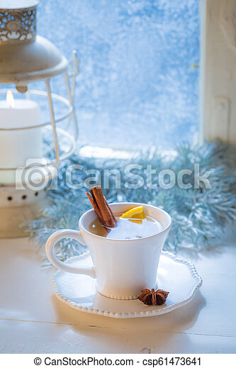 Sweet and hot tea with orange and cinnamon for Christmas - csp61473641