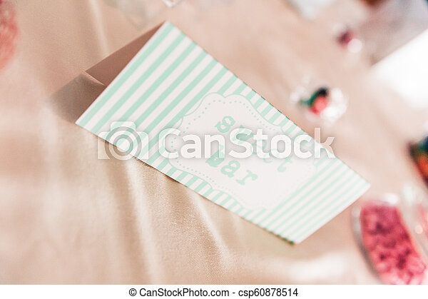 Sweet Bar Paper Sign on Wedding Table with Coloured Sweets - csp60878514