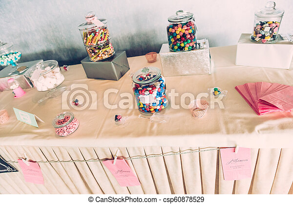 Sweet Bar Paper Sign on Wedding Table with Coloured Sweets - csp60878529