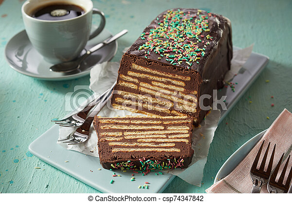 Sweet chocolate cake with biscuits and topping - csp74347842
