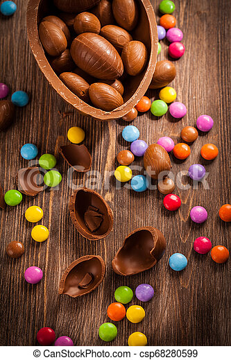 Sweet chocolate eggs and smarties for Easter - csp68280599
