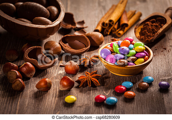 Sweet chocolate eggs and smarties for Easter - csp68280609