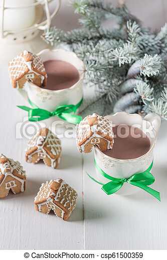 Sweet gingerbread cottages with hot chocolate for Christmas - csp61500359