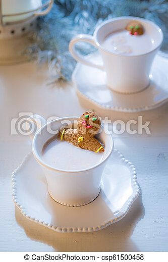 Sweet gingerbread man in hot chocolate for Christmas - csp61500458