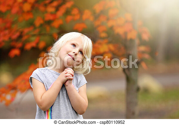Sweet Little Girl Child Praying as She Looks up to the Sky - csp80110952