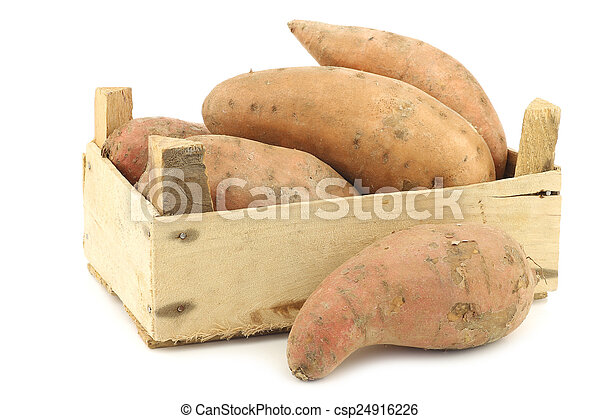 Sweet potatoes in a wooden crate - csp24916226