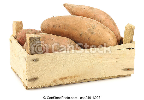 Sweet potatoes in a wooden crate - csp24916227