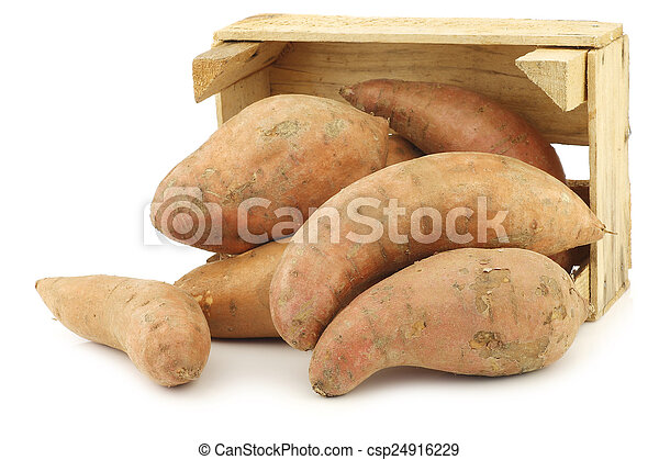 Sweet potatoes in a wooden crate - csp24916229
