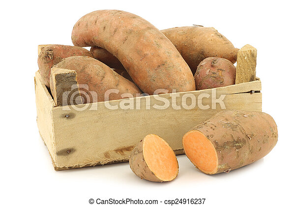 Sweet potatoes in a wooden crate - csp24916237