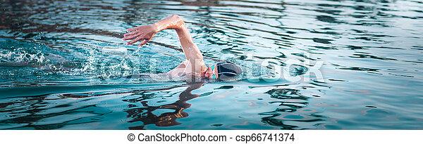 Swimmer breathing during swimming crawl. Panorama - csp66741374
