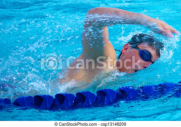 Swimmer Taking a Quick Breath Doing Freestyle - csp13148209