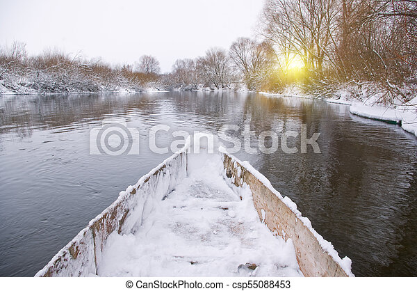 Swimming in a boat on winter river - csp55088453