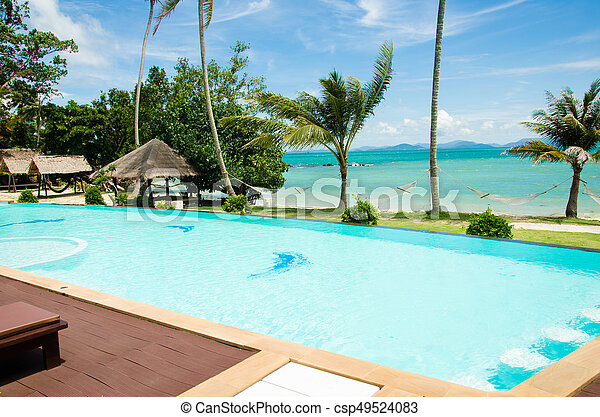 Swimming pool by the sea - csp49524083