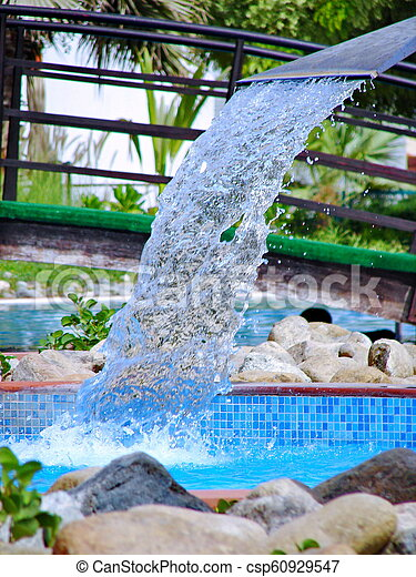 Swimming pool in spa with waterfall jet
