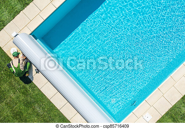 Swimming Pool Technician Cleaning Skimmer Filter - csp85716409
