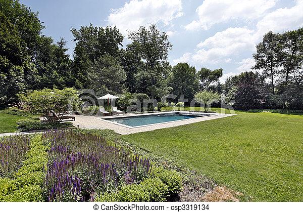 Swimming pool with brick deck - csp3319134