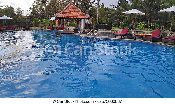 Swimming Pool With Deck Chair Sun Umbrella And Exotic Plants Near