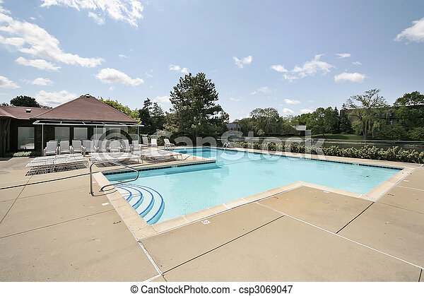 Swimming pool with deck chairs - csp3069047