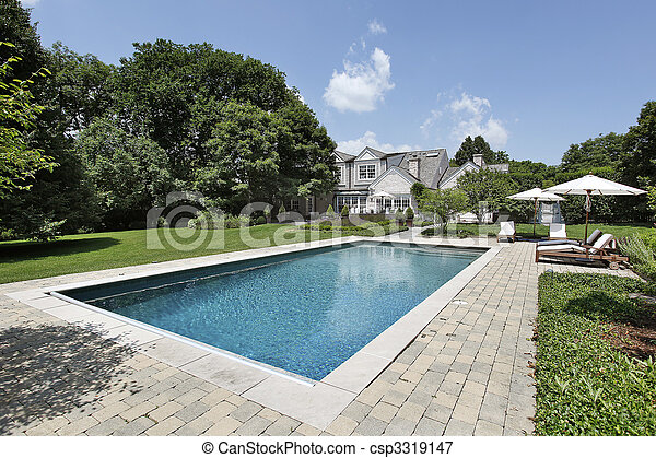 Swimming pool with deck chairs - csp3319147
