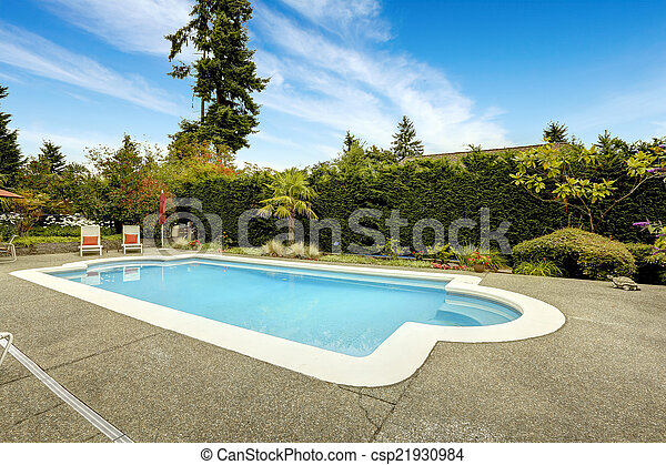 Swimming pool with deck chairs - csp21930984