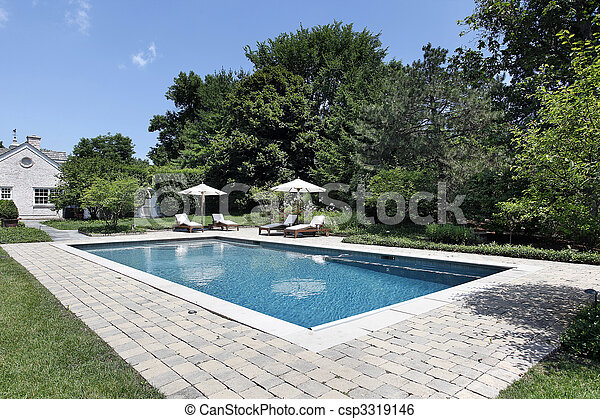 Swimming pool with deck chairs - csp3319146