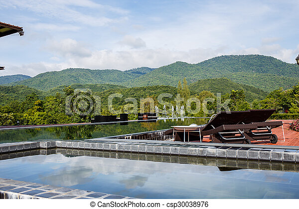 Swimming pool with mountain. - csp30038976