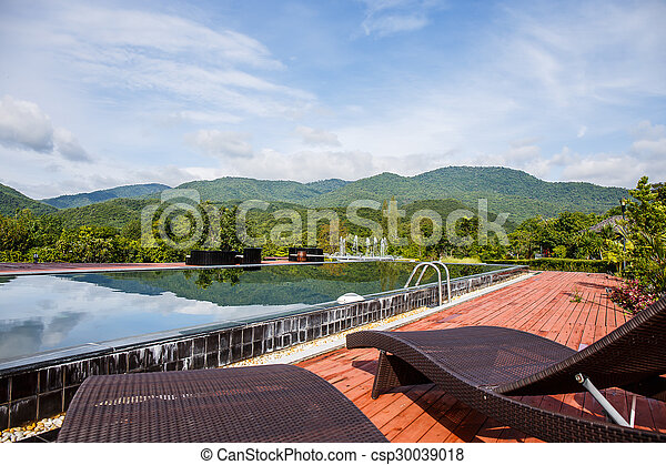 Swimming pool with mountain. - csp30039018