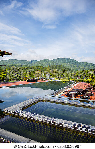 Swimming pool with mountain. - csp30038987
