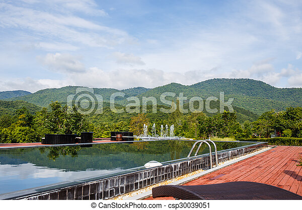 Swimming pool with mountain. - csp30039051