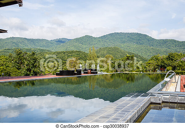 Swimming pool with mountain. - csp30038937