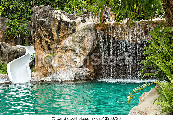 Swimming pool with waterfall and slide at high resolution