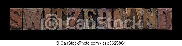 Switzerland in old wood type - csp5625864