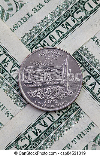 Symmetric composition of US dollar bills and a quarter of Arizona. - csp84531019