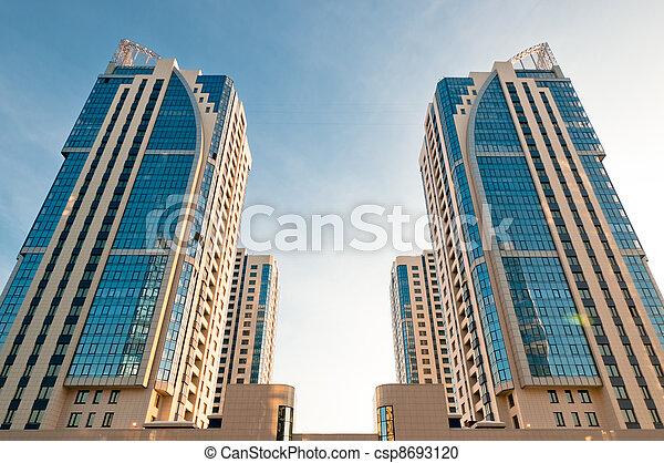 Symmetrical house towers - csp8693120 & Symmetrical house towers. Symmetrical new house and offices towers ...