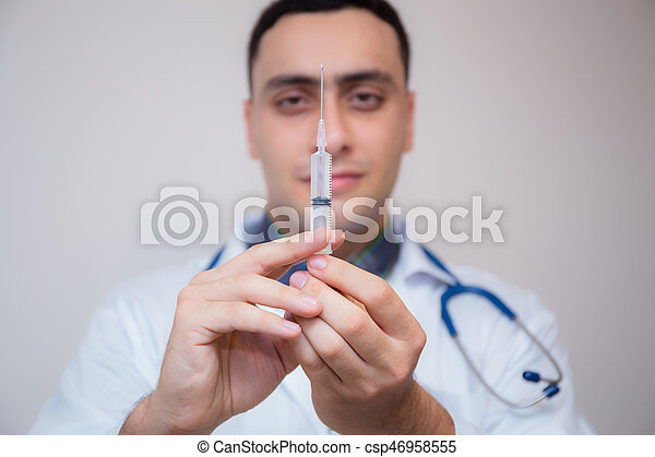 Syringe - medical injection in hand -Medicine plastic with holding doctor vaccination equipment - Health care in hospital. - csp46958555