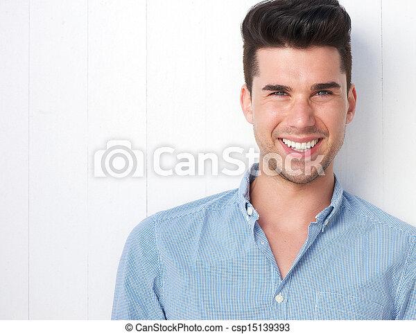 szczęśliwy, młody, portret, człowiek, uśmiechanie się - csp15139393