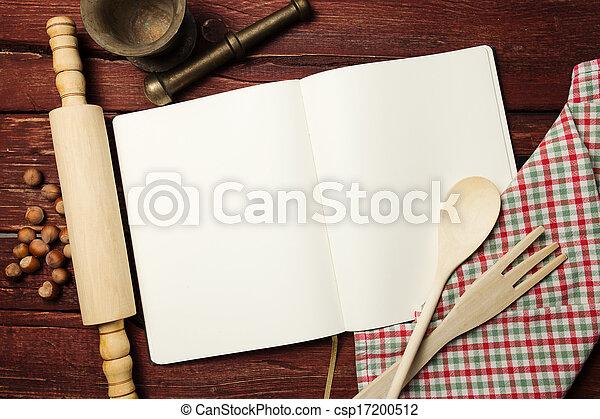 Libro de recetas en blanco en la mesa de madera - csp17200512