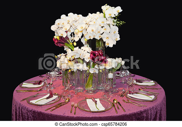 Table decorated for a wedding dinner - csp65784206