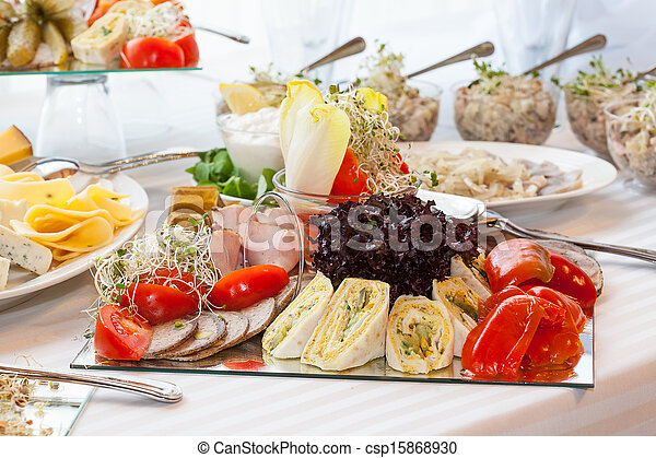 Table full of appetizers - csp15868930