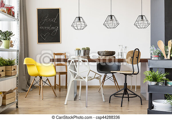Table in spacious dining room - csp44288336