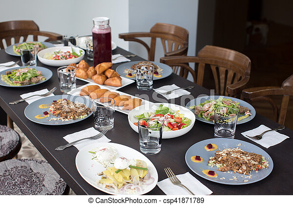 Table laid for a family dinner - csp41871789