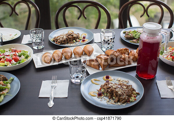 Table laid for a family dinner - csp41871790