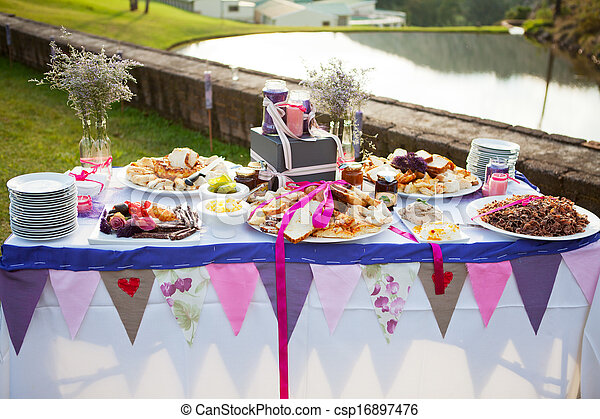 Table laid with fresh bread and condiments at wedding - csp16897476