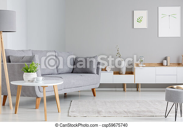 Phenomenal Table Next To Grey Sofa In Scandi Living Room Interior With Posters Above Cupboard Real Photo Uwap Interior Chair Design Uwaporg